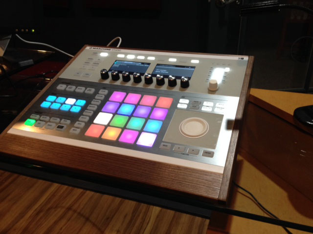 white maschine studio with walnut panels by mixingtable.com
